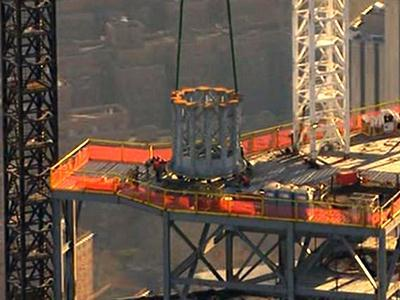 Raw: First section of WTC spire hoisted
