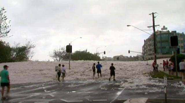 Raw: Sea foam blankets Australian beach town