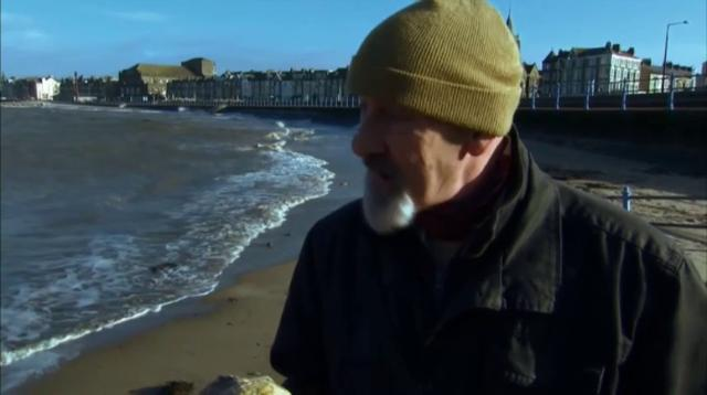 On a beach, dog sniffs out valuable whale vomit