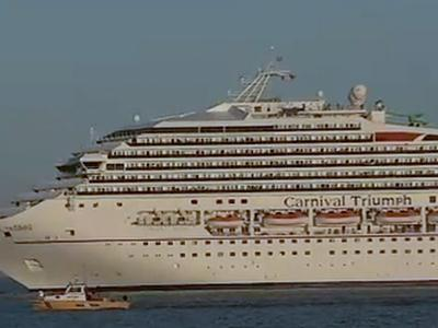 Raw: On the water with the crippled cruise ship