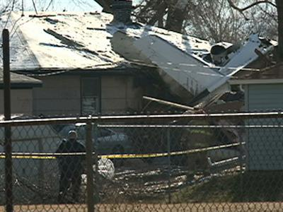 Two killed when private jet hits 3 homes