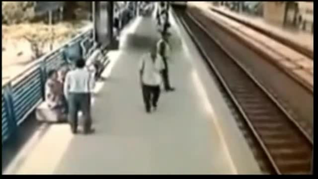Raw video: Cop saves man from speeding train
