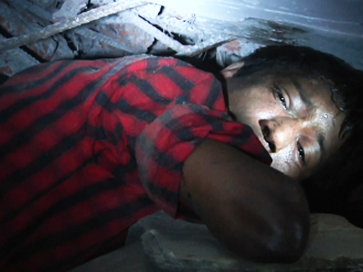 In Bangladesh factory rubble, cries for help