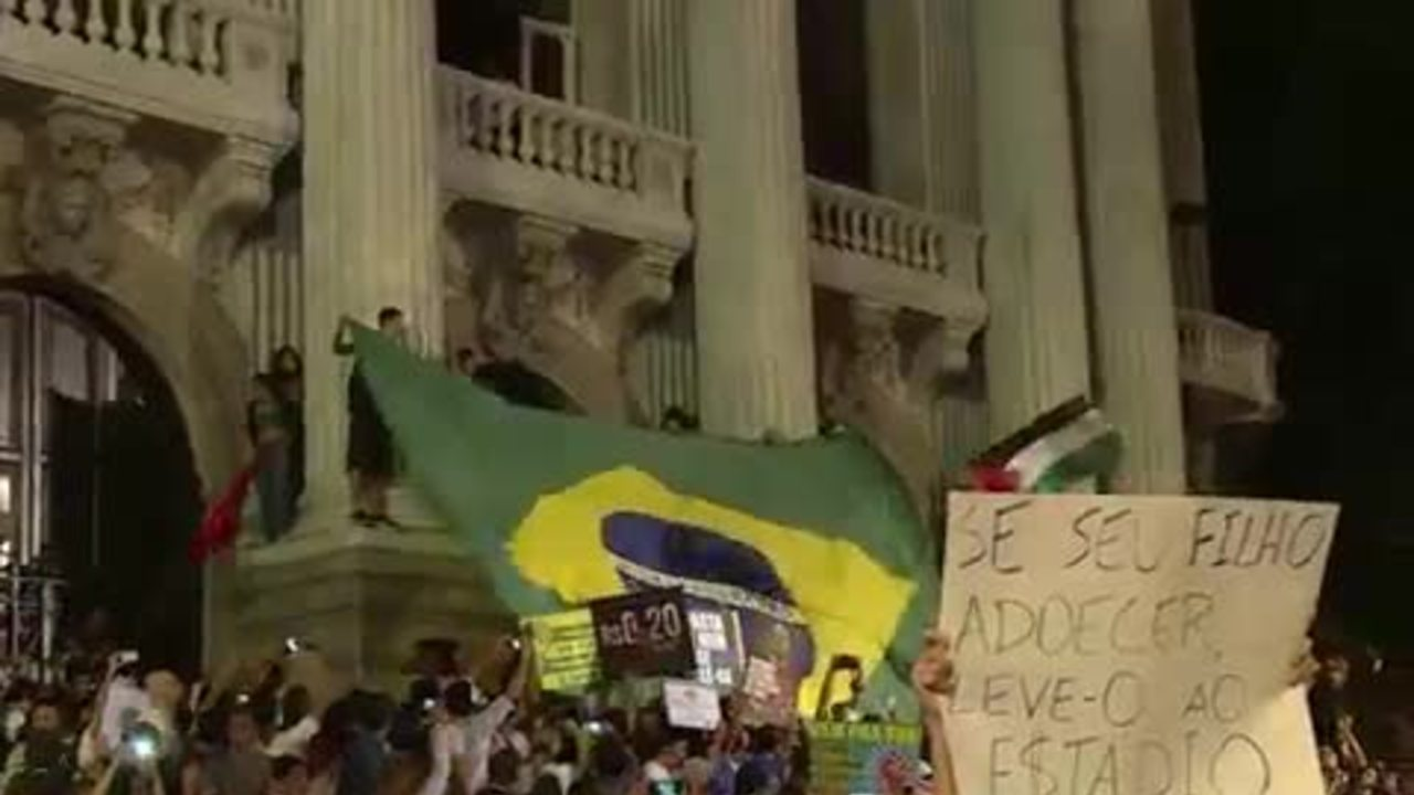 Demonstrators shout slogans outside the Municipal theater in downtown Rio de Janeiro on Monday.