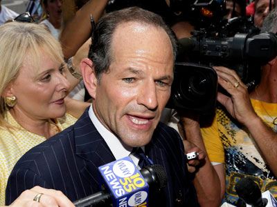 Former New York Gov. Eliot Spitzer walks to a cab after trying to collect signatures for his run for New York City comptroller.