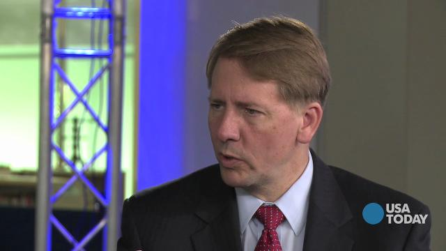 Cordray announces he's leaving consumer bureau, promotes aide to deputy director