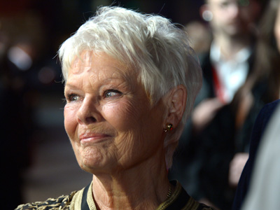 Firefighters serenade Judi Dench in London