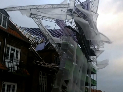 Raw: Storm rips scaffolding from building
