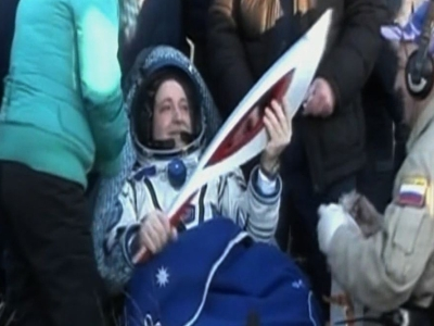 Olympic torch returns home from space station