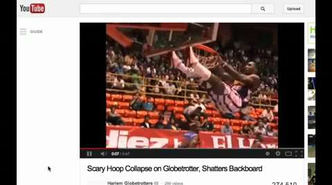 Backboard almost crushes Globetrotter during dunk | ZoomIN