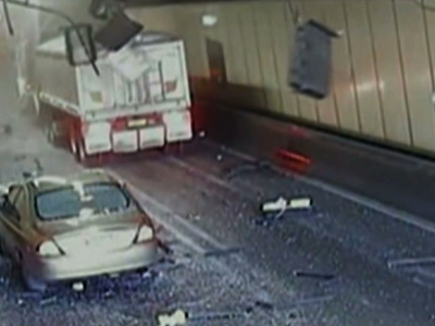 Raw: Truck Hits Tunnel Roof