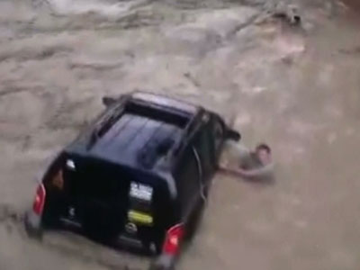 Raw: Bolivian flood sweeps cadet and soldier away