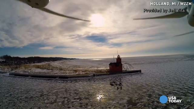 Drone captures stunning images of Lake Michigan ic...