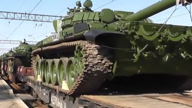 Russian soldiers unload modified T-72 tanks after their arrival in Gvardeyskoe railway station near the Crimean capital Simferopol on March 31.