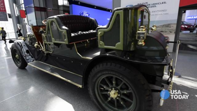 Photographer shoots Horseless eCarriage by coachbuilder Jason Wenig of The Creative Workship at 2014 New York auto show April 17. It could replace iconic horse-drawn carriages that tourists love for romantic rides through Centra Park.