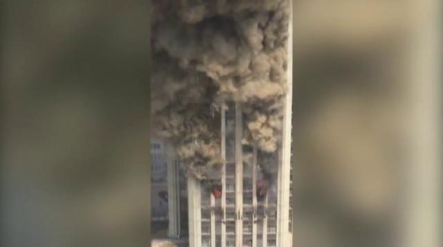 Raw: Fire engulfs tower block in China