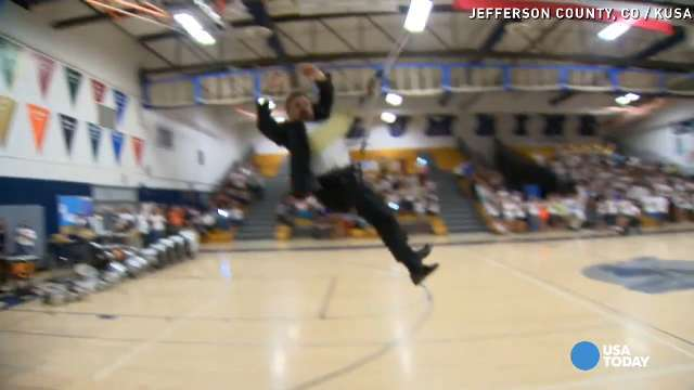 This principal goes on a zipline for his last assembly