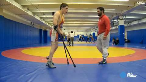 Watch kid with Cerebral Palsy wrestle Olympic coach