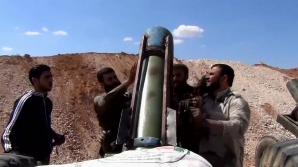 Rebels battle for a checkpoint in Syria