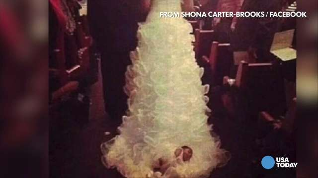 Baby attached to wedding dress dragged down aisle | ZoomIN