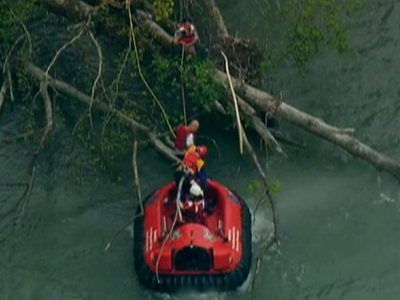 Raw: Two Rafters Rescued After Raft Flips