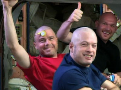 Raw: NASA astronauts shave head for USA loss