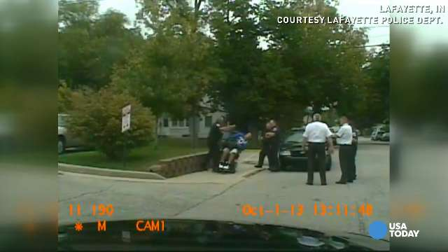 Video shows officer shoving man in wheelchair