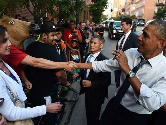 Obama greeted by horse head in Denver