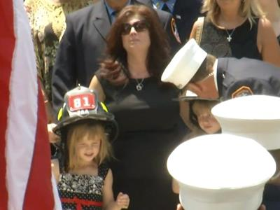 Thousands attend NYC firefighter's funeral