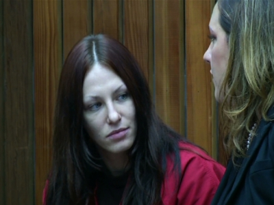 Prostitute in exec's death pleads not guilty