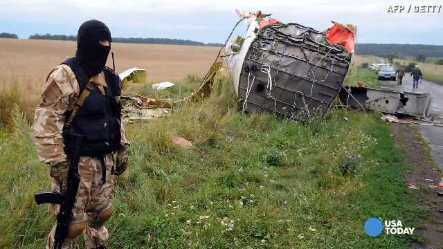 Ukraine, rebels agree on secure zone around MH17 site | USA NOW