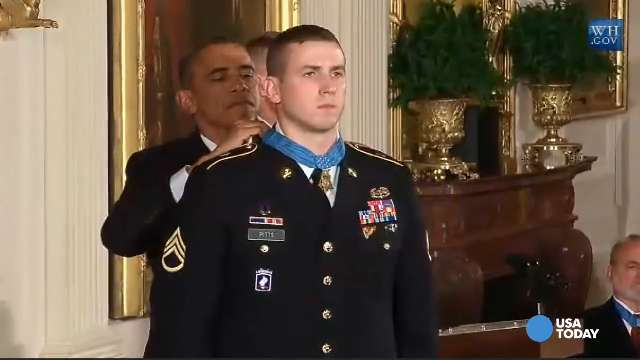 President Obama awards Ryan Pitts, a former Army staff sergeant, the Medal of Honor for conspicuous gallantry on Monday at the White House.