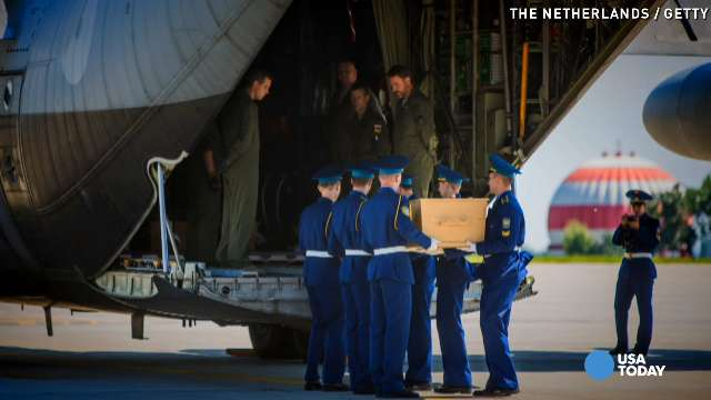 A coffin containing the body of a victim of the crash of Malaysia Airlines flight MH17 is loaded onto a plane for transport to the Netherlands during a departure ceremony on Wednesday in Kharkiv, Ukraine.