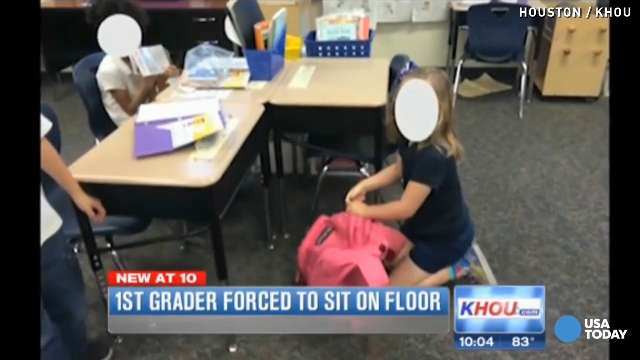 A first grade student was forced to sit on the floor after drawing on her desk.