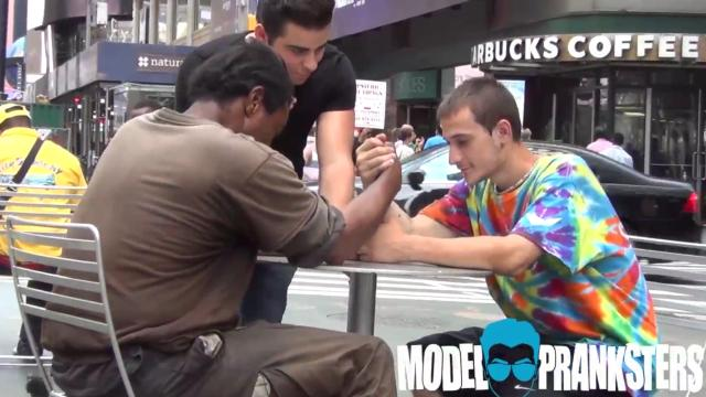 Pranksters ask homeless men to arm wrestle for money