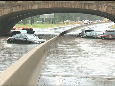 Raw: Drivers trapped on flooded NY highway