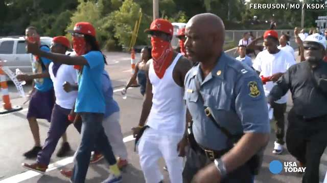 Trooper in charge in Ferguson marches with protestors | USA NOW