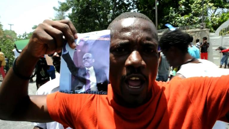 Protest in Haiti against arrest warrant issued for ex-president