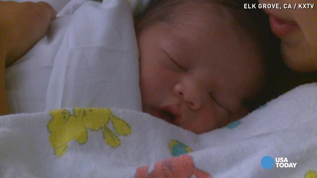 Police officer delivers baby in parking lot