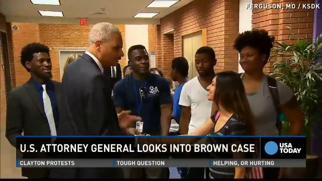 Eric Holder arrives in Ferguson
