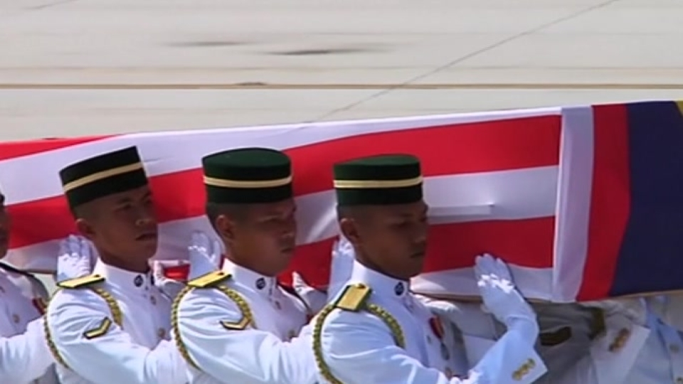 First bodies of Malaysian victims arrive home