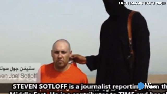 A man militants claim is journalist Steven Sotloff is shown in a video.