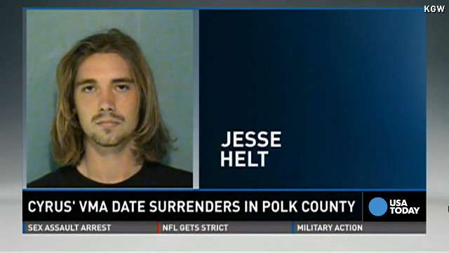 Miley Cyrus' VMA date turns himself in to Oregon jail