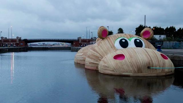 An adorable giant Hippo in the Thames River