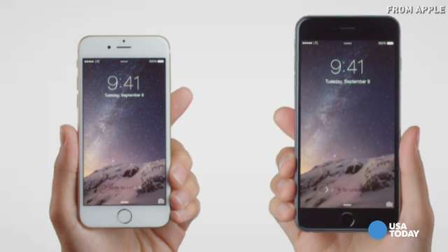 The new iPhone 6, left, and iPhone 6 Plus.