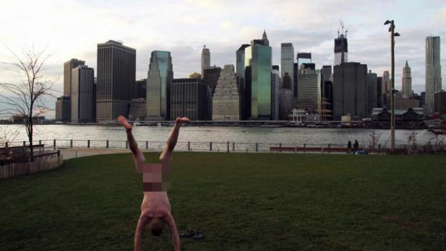 Naked handstands for a good cause
