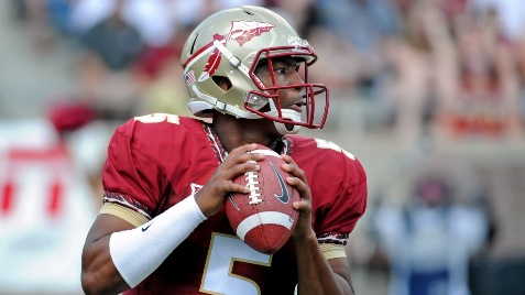Florida State   coach Jimbo Fisher talks to quarterback Jameis Winston (5) before a series against The Citadel on Sept. 6.