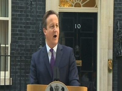 British Prime Minister David Cameron addresses the media outside 10 Downing