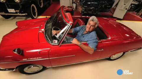 Jay Leno poses with his 1966 NSU Wankel Spider.