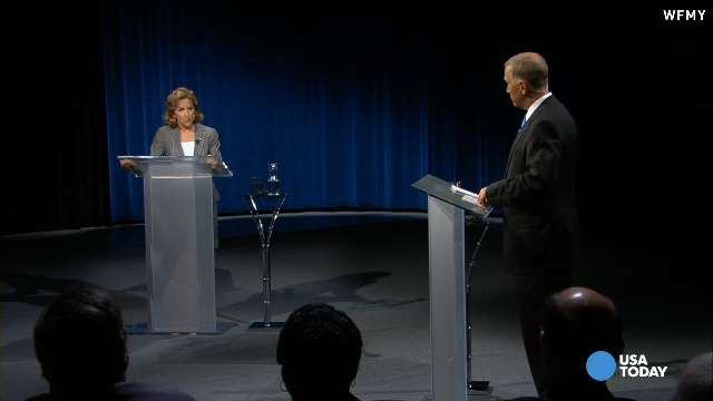 In this Sept. 3, 2014, file photo, Sen. Kay Hagan, D-N.C., left, and GOP Senate candidate Thom Tillis participate in a debate at UNC-TV studios in Research Triangle Park, N.C.